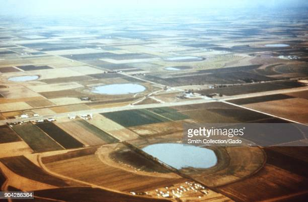Aerial photograph of playa lakes full of stagnant water with fields around them in Texas a site relevant to the CDC investigation of vectorborne...