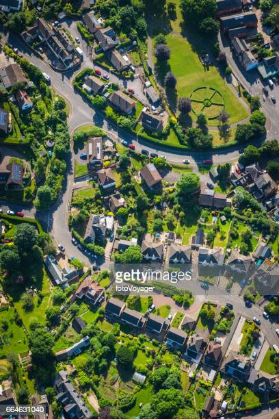 Aerial photograph of summer suburbs family homes green gardens