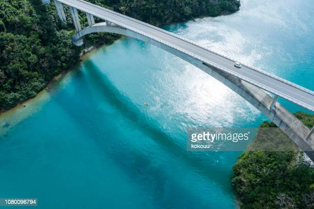 aerial photograph of the beautiful sea and bridge. - bridge stock pictures, royalty-free photos & images