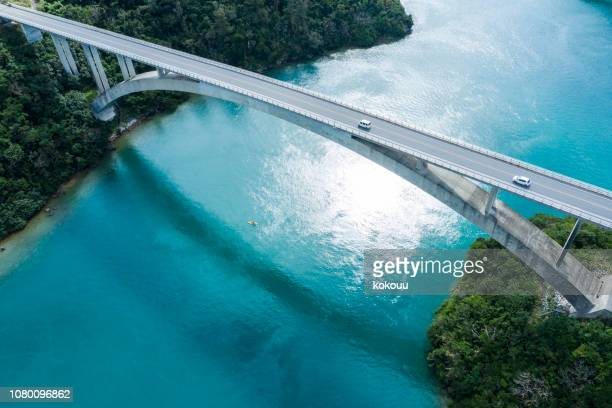 aerial photograph of the beautiful sea and bridge. - emerald green stock pictures, royalty-free photos & images