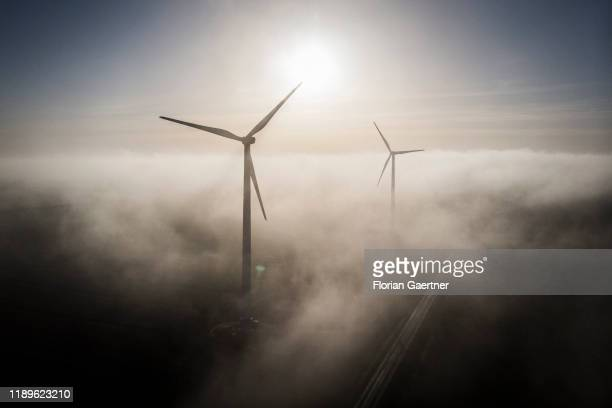 Aerial photograph of wind turbines in the foggy morning on December 19 2019 in Wischer Germany