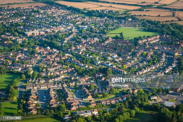 aerial photograph over suburban family homes surrounded by countryside uk - gloucester england stock pictures, royalty-free photos & images