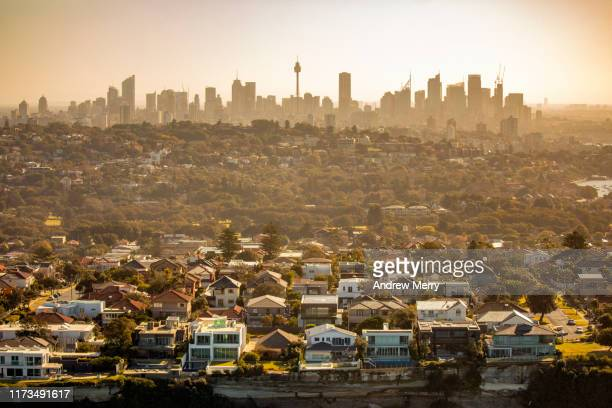 aerial photography of sydney skyline cityscape, suburb and houses on costal sea cliff, australia - australia stock pictures, royalty-free photos & images