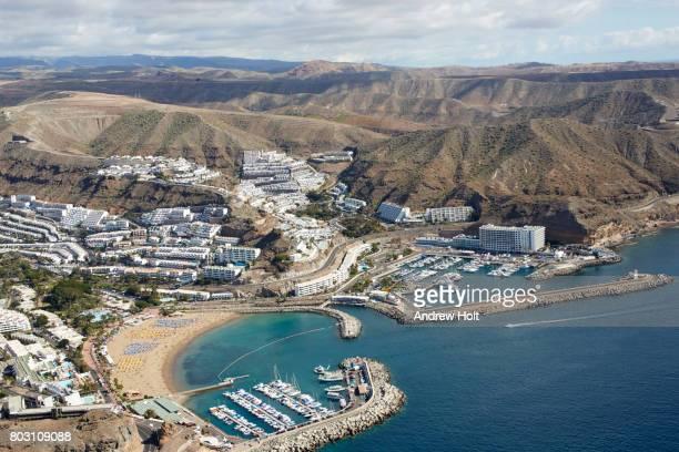 Aerial photography view east of Playa de Amadores and Punta del Tablero, Gran Canaria. Canary Islands, Spain.