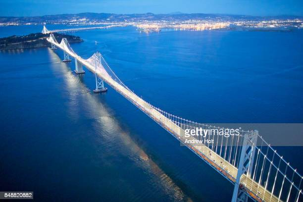 Aerial photography view north-east of San Francisco-Oakland Bay Bridge San Francisco Bay Area in the evening. California, United States.