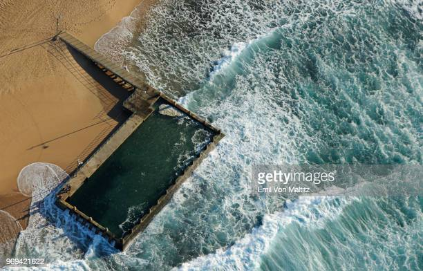 aerial photography view point of brighton beach tidal pool (rock pool), on durban's coastline, kwazulu natal, south africa. full colour horizontal image, wide angle, waves crashing onto the beach - durban beach stock photos and pictures