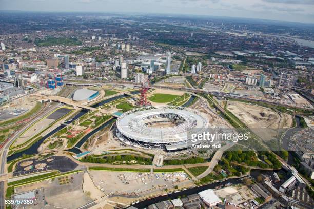 aerial photography view south-east of queen elizabeth olympic park and stadium. e20  london uk. - olympic stadium london stock pictures, royalty-free photos & images
