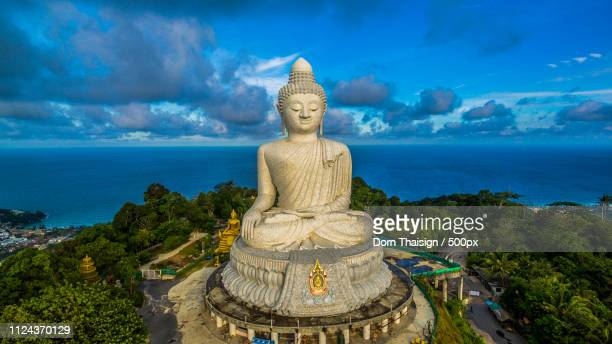 aerial photography white great phuket big buddha in blue sky - buddha foto e immagini stock