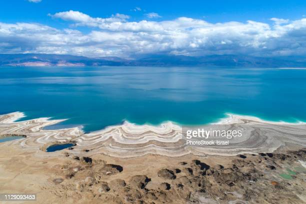 aerial photography with drone. elevated view of dead sea shoreline, israel - dead sea stock pictures, royalty-free photos & images