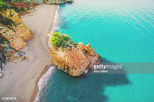 Aerial picture of a beautiful beach with turquoise water and island in the Mediterranean Costa Brava.