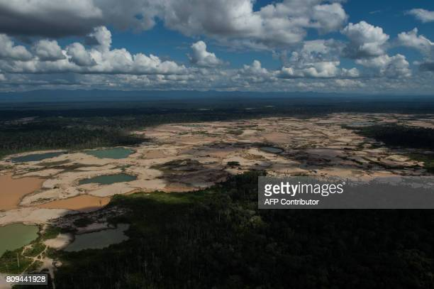 Aerial picture of an illegal gold mining camp in La Pampa in Madre de Dios southern Peruvian jungle on July 05 2017 In an unprecedented operation...