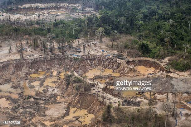 Aerial picture of an illegal gold mining camp in the area of La Pampa in Madre de Dios southern Peruvian jungle on July 14 2015 In an unprecedented...