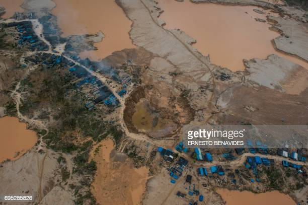 Aerial picture of dredges in the illegal gold mining area of La Pampa next to the interoceanic highway between Peru and Brazil in the Madre de Dios...