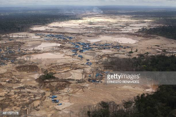 Aerial picture of the illegal gold mining area of La Pampa in Madre de Dios southern Peruvian jungle on July 14 2015 In an unprecedented operation in...