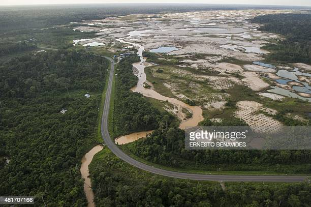 Aerial picture of the illegal gold mining area of La Pampa next to the interoceanic highway between Peru and Brazil in the Madre de Dios southern...