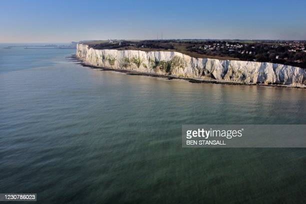 Aerial picture show the white chalk cliff's of St Margaret's Bay and the Port of Dover on the south coast of England on January 25, 2021. - EU...