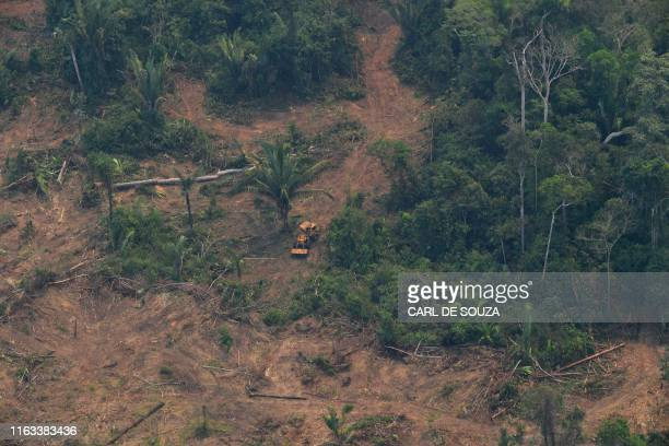 Aerial picture showing a deforested piece of land in the Amazon rainforest near an area affected by fires about 65 km from Porto Velho in the state...