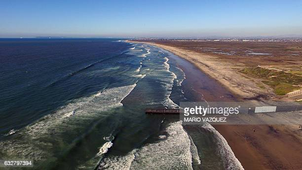 Aerial picture taken with a drone of the urban fencing on the border between the US and Mexico at Playas de Tijuana northwestern Mexico on January 26...