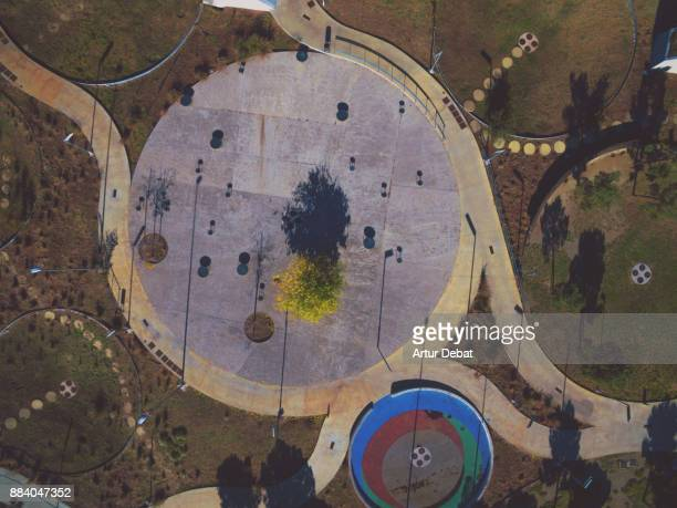 Aerial picture taken with drone flying from directly above in a nice public park in Barcelona city with nice geometries and cool pattern.