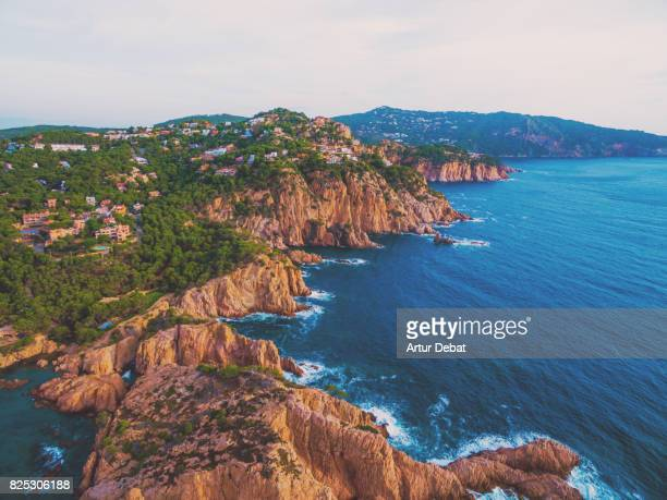aerial picture taken with drone flying over the stunning costa brava in the mediterranean sea with rocky terrain and stunning landscape. - catalonia stock pictures, royalty-free photos & images