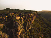 Aerial picture taken with drone flying over the stunning Siurana town in top of cliff with nice views in the Tarragona mountains during travel vacations.
