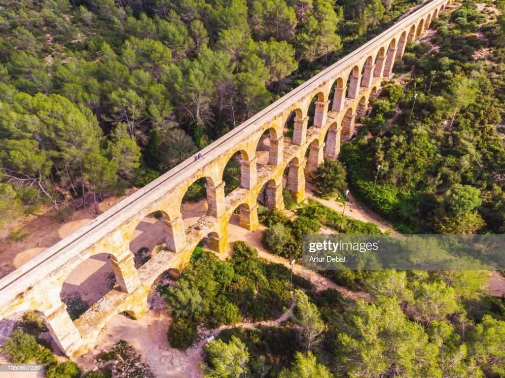 Aerial picture taken with drone of the beautiful Tarragona Roman bridge. : Stock Photo