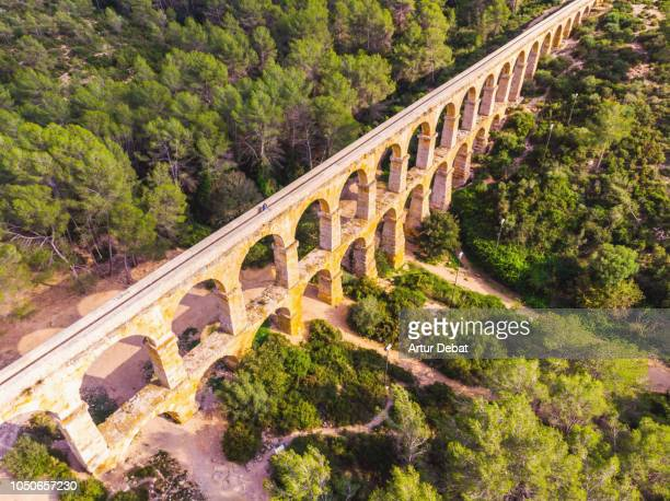 aerial picture taken with drone of the beautiful tarragona roman bridge. - ancient history stock pictures, royalty-free photos & images