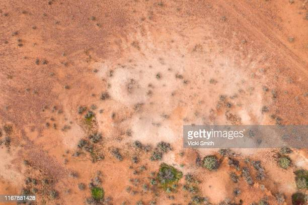 aerial point of view over the red and white earth of the australian outback at white cliffs new south wales - drone point of view stock pictures, royalty-free photos & images