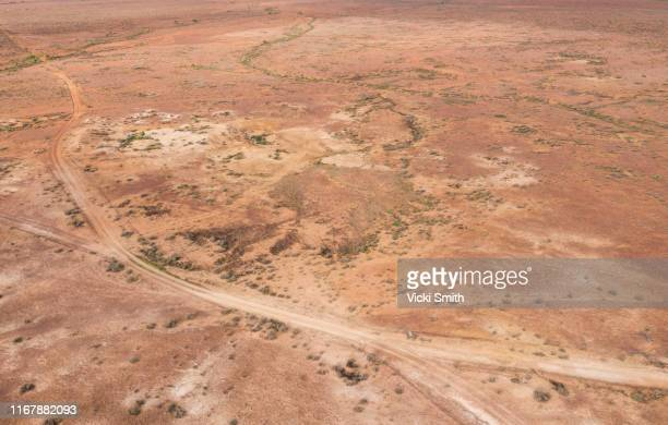 aerial point of view over the red and white earth of the australian outback at white cliffs new south wales - drought stock pictures, royalty-free photos & images