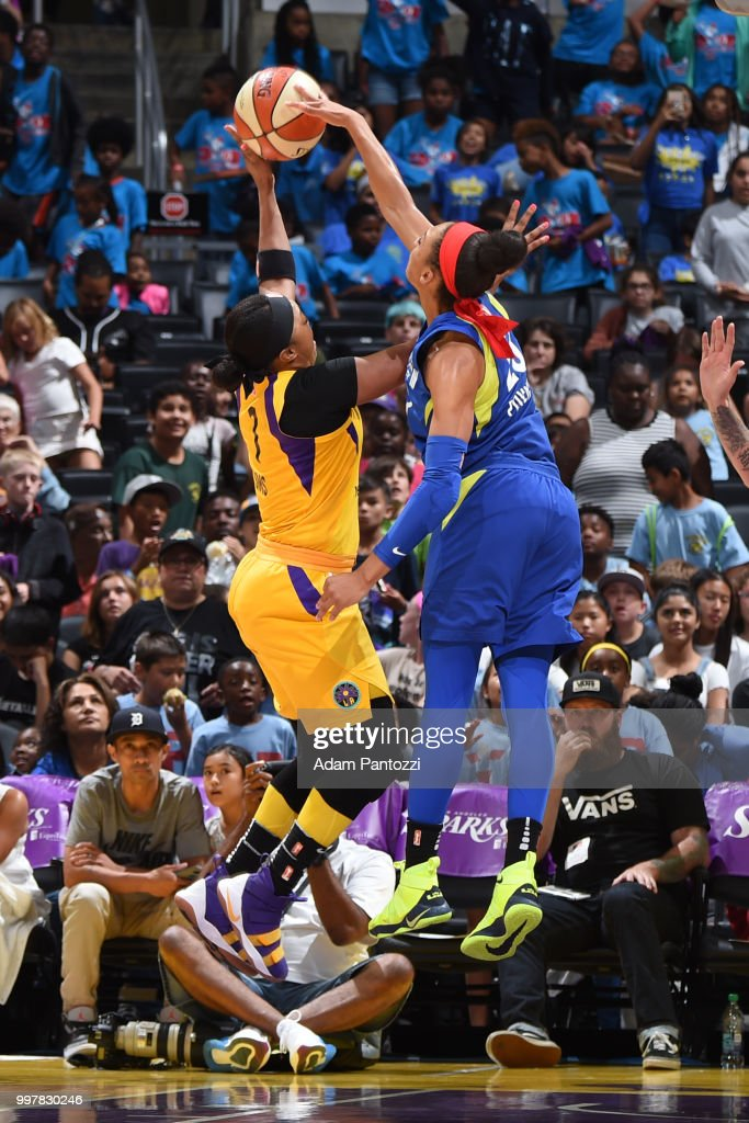 Aerial Powers #23 of the Dallas Wings blocks a shot against Odyssey Sims #1 of the Los Angeles Sparks on July 12, 2018 at STAPLES Center in Los Angeles, California.