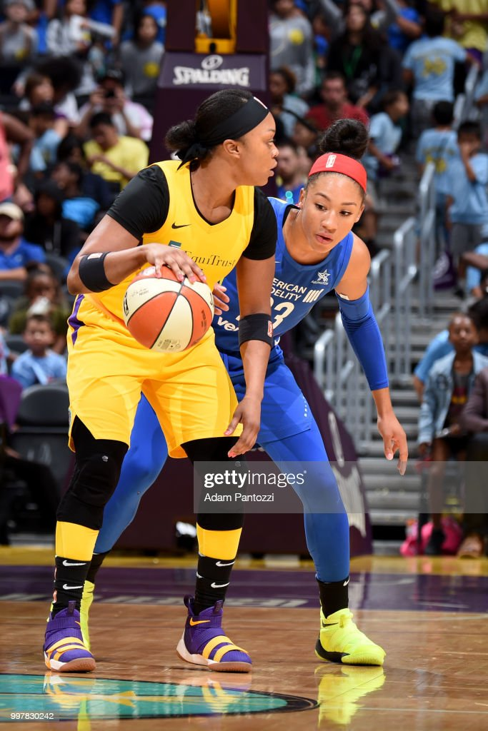 Aerial Powers #23 of the Dallas Wings defends against Odyssey Sims #1 of the Los Angeles Sparks on July 12, 2018 at STAPLES Center in Los Angeles, California.