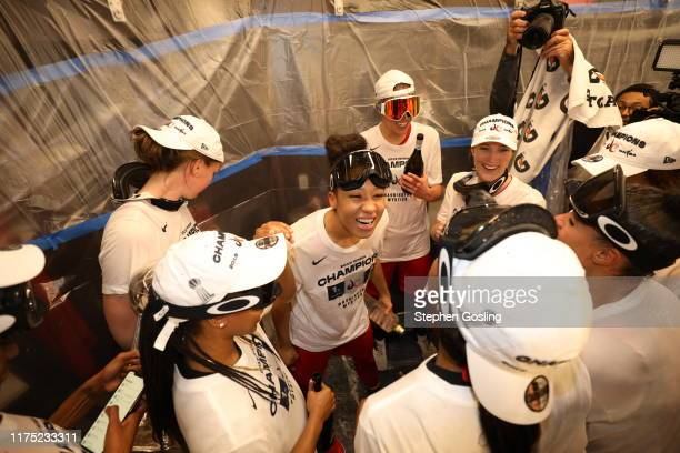 Aerial Powers of the Washington Mystics celebrates in the locker room after winning the 2019 WNBA Finals against the Connecticut Sun during Game Five...