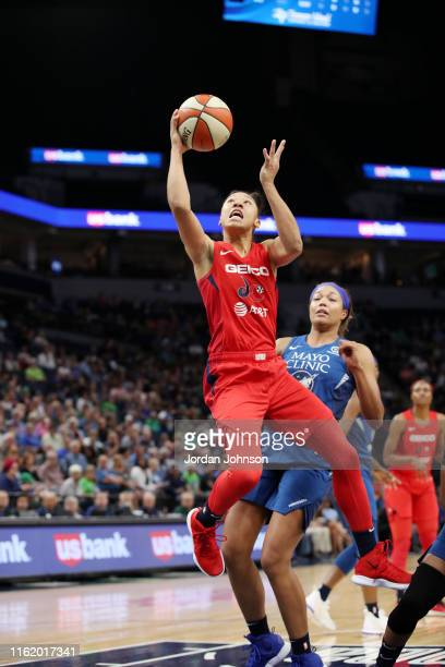Aerial Powers of the Washington Mystics shoots the ball against the Minnesota Lynx on August 16 2019 at the Target Center in Minneapolis Minnesota...