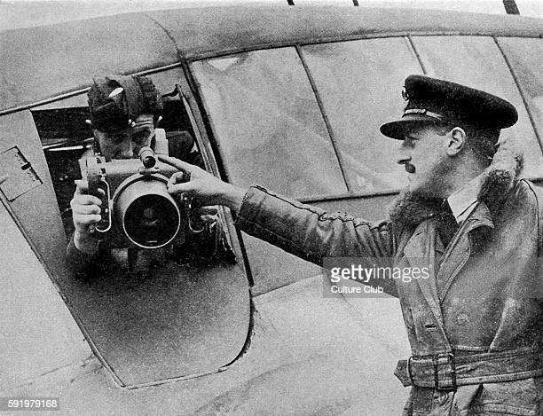 WW2 Aerial Reconnaissance Man being instructed how to use an aerial camera on a plane