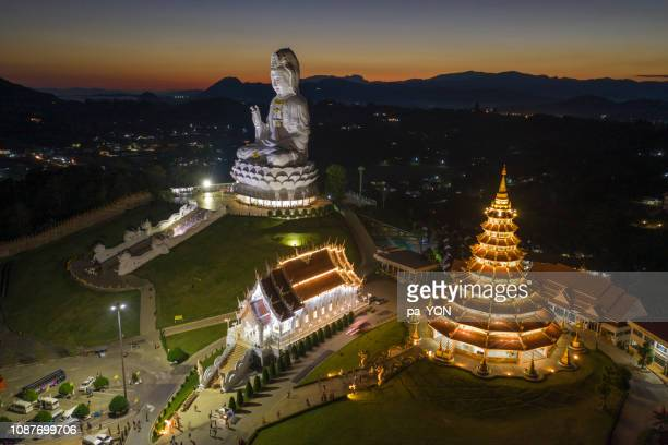 aerial scene of guanyin statue wat huay pla kang, chiang rai in sunset scene - buddhist goddess stock pictures, royalty-free photos & images