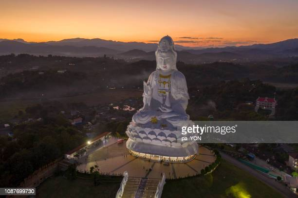 aerial scene of guanyin statue wat huay pla kang, chiang rai in sunset scene - guanyin bodhisattva stock pictures, royalty-free photos & images