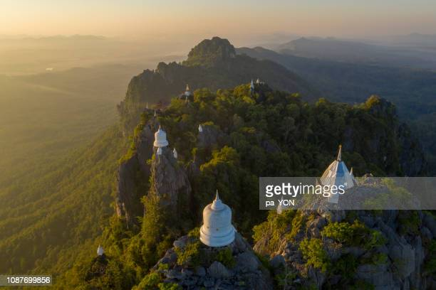 aerial scene of temple at the cliff on top of mounain, wat chaloem phra kiat lampang chiang mai, north of thailand - wat stock pictures, royalty-free photos & images