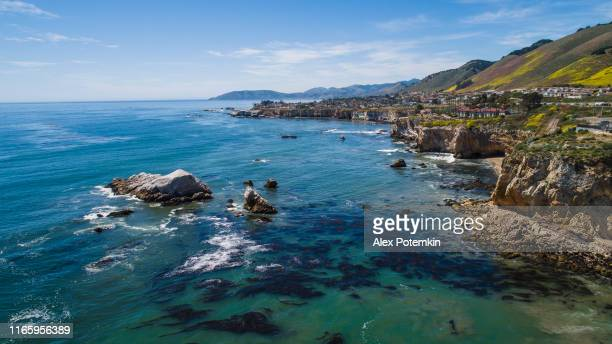 aerial scenic view of cliffs and rocks in the pacific ocean nearby pismo beach, californian west coast, in the sunny spring day. - flowing cape stock pictures, royalty-free photos & images