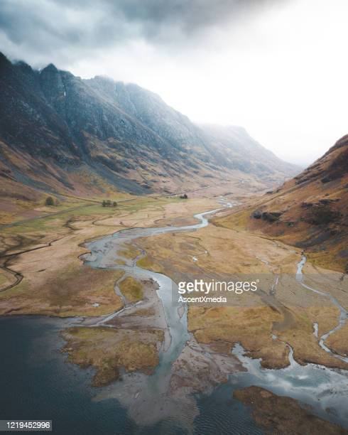 aerial scenic view of rugged mountain landscape - river stock pictures, royalty-free photos & images
