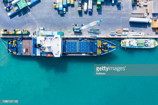 aerial shooting in the logistics area. container ship to anchor. - commercial dock stock pictures, royalty-free photos & images