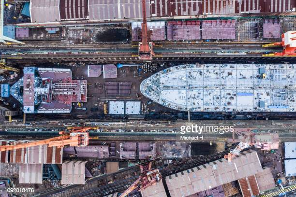 aerial shooting of a shipyard.viewpoint from directly above. - 工場地帯 ストックフォトと画像