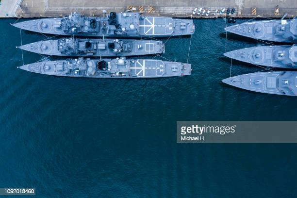 aerial shooting of battleships anchored. viewpoint from directly above. - navy ship stock pictures, royalty-free photos & images