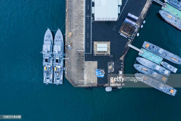 aerial shooting of warships anchored in the harbor. - military ship stock pictures, royalty-free photos & images