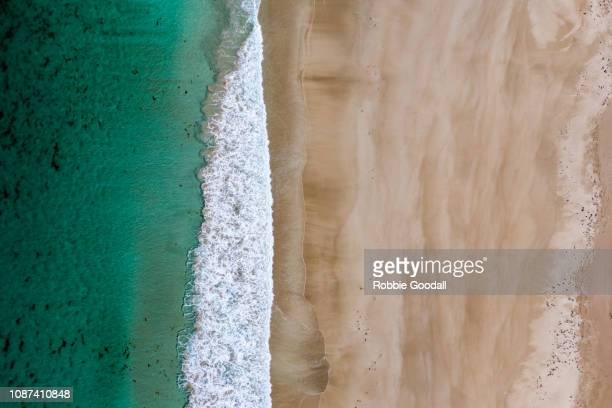 aerial shot above sandy beach - illustration technique stock pictures, royalty-free photos & images
