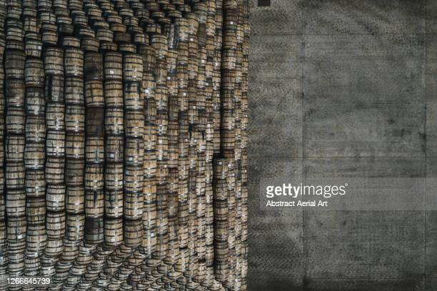 aerial shot at the edge of a pile of alcohol barrels, scotland, united kingdom - stack stock pictures, royalty-free photos & images