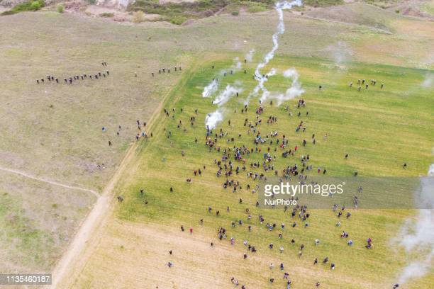 Aerial shot from a drone of the chaos with clashes between refugees migrants and the police Migrants tried to march to the Northern Greek borders...