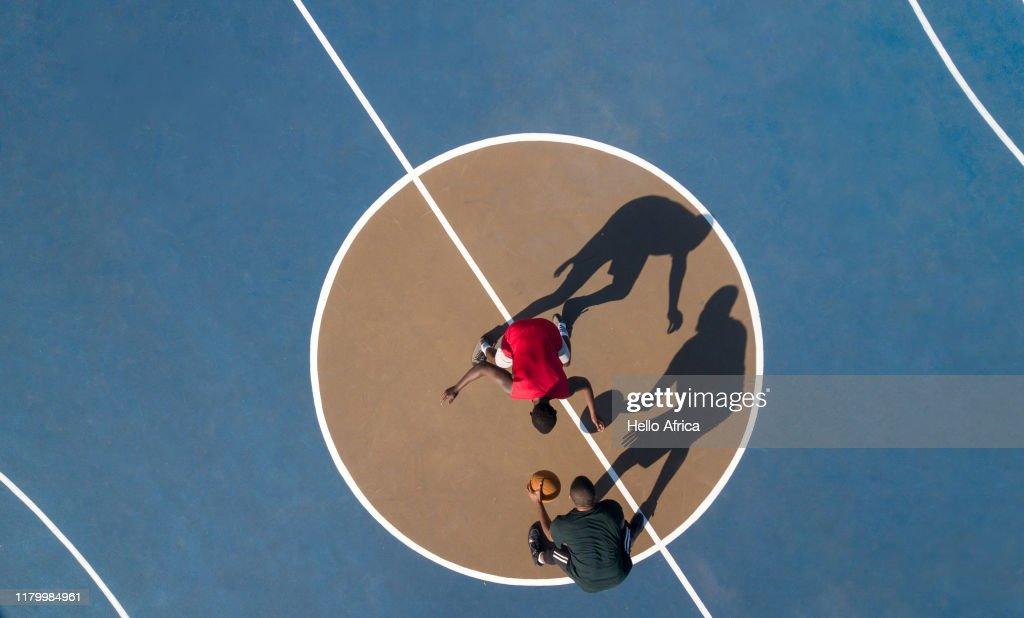 Aerial shot of 2 basketball players and shadows : Photo