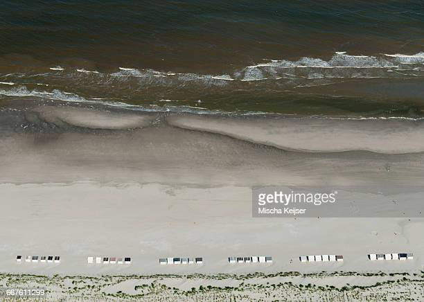 aerial shot of a beach with beach cabins, monster, south holland, netherlands - south holland stock pictures, royalty-free photos & images