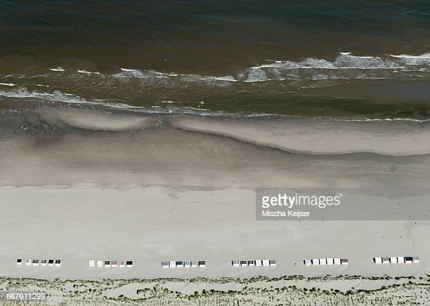 aerial shot of a beach with beach cabins, monster, south holland, netherlands - zuid holland stockfoto's en -beelden