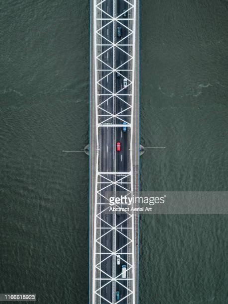aerial shot of a bridge crossing a river channel, netherlands - drönare transportmedel bildbanksfoton och bilder